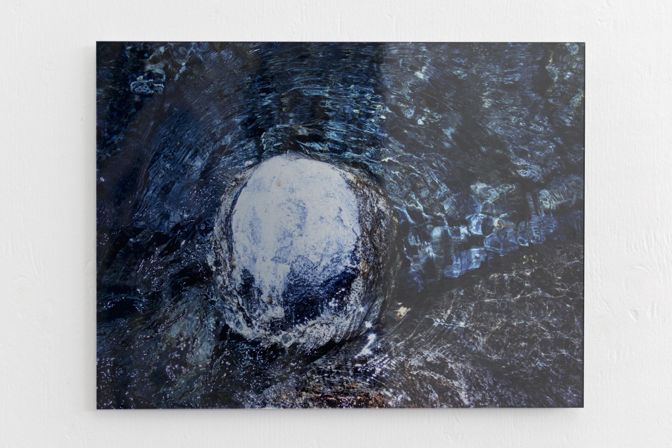 Maya Rochat, A Rock is A River, 2017. inkjet on metallic paper, polished glass. 30 x 21cm.