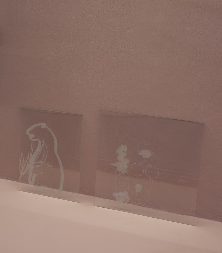 Lauren Godfrey, Panther Plant, 2016. Sandblasted glass. 31 x 41 cm; Director's Bottle, 2016. Sandblasted glass. 45 x 45 cm. Photographer: Jonathan Bassett.