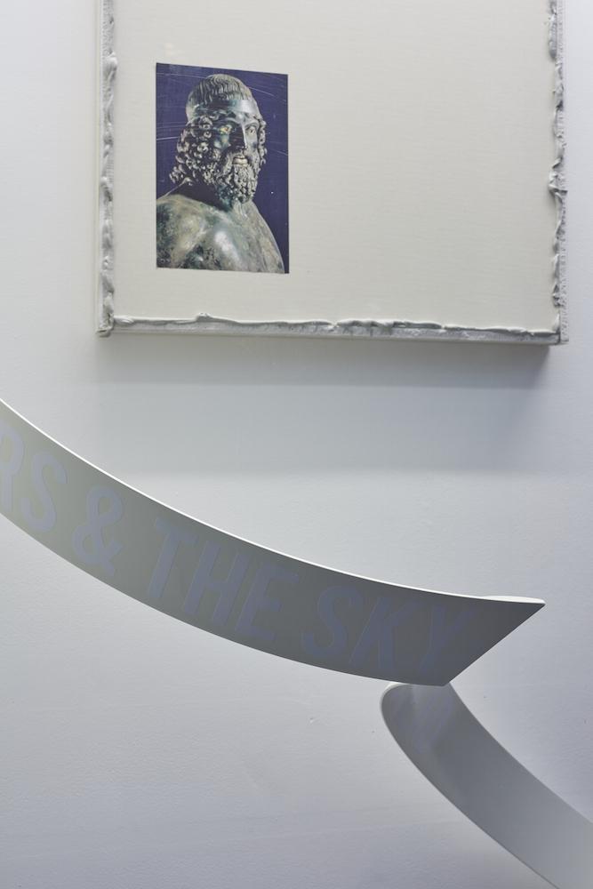 Paul Merrick, Untitled (Warrior), 2015. Plasterboard, mastic, found image. 63 x 63 x 5 cm; Aethan Wills, PINK SAKURA (BLACK RAIN), 2016. Steel, cellulose paint, vinyl text, vintage kirin beer mats. 250 x 10 x 3 cm. Photographer: Jonathan Bassett.