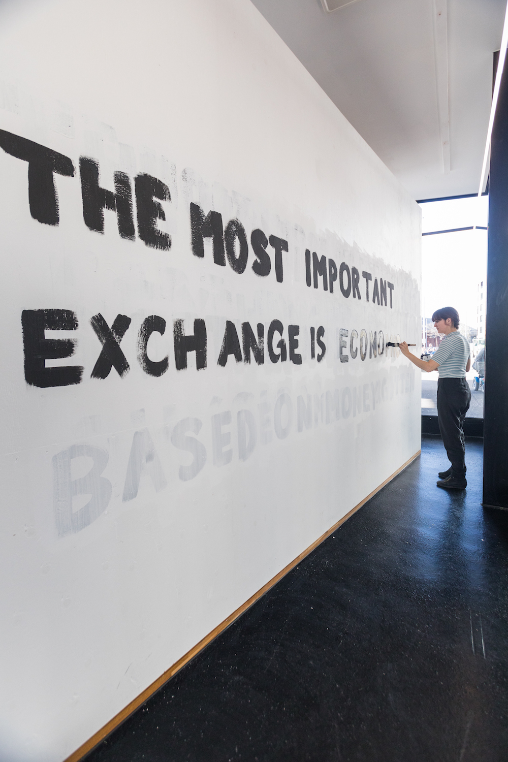 "Tim Etchells, Further Provocations, 2016. Wall painting. 45 phrases, each begining with ""THE MOST IMPORTANT EXCHANGE..."". Photographer: Nicolas Gysin."