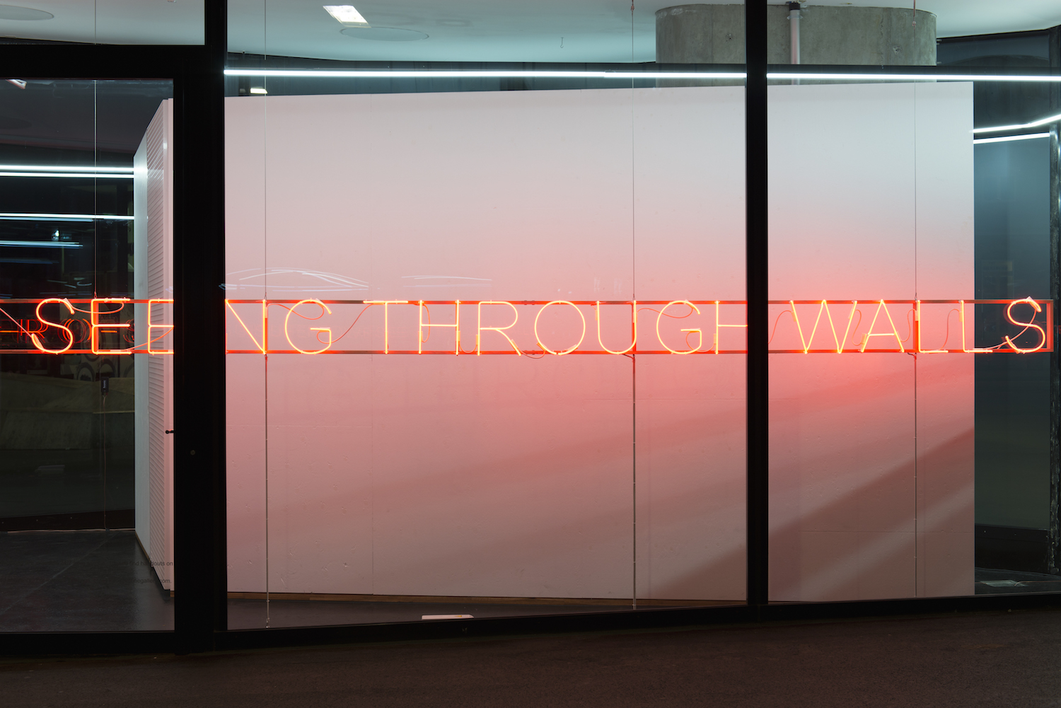 Tim Etchells, SEEING THROUGH WALLS, 2017. Neon (red), four transformers, cables, white oak frame, steal wire. 27.5 x 1001 x 10 cm. Edition 3 (+1AP). Photographer: Nici Jost.