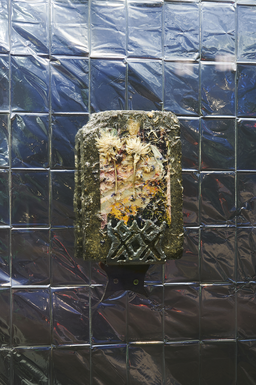 Suzanna Zak, Moss Soak, 2018. Hand plasma cut steel bracket, landscaping stone, resin, petals, c-print. 38 x 20.5 x 8.5 cm. VITRINE, Basel. Photographer: Nici Jost.