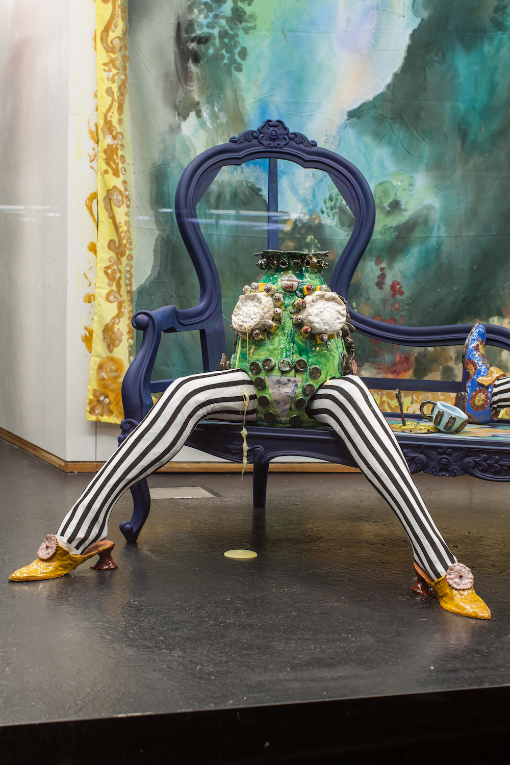 Lindsey Mendick, The Spectre at The Feast, 2018. Glazed ceramic, papier mâché, tights, chaise longue, acrylic paint, camembert. 111 x 112 x 166 cm. Photographer: Nicolas Gysin.