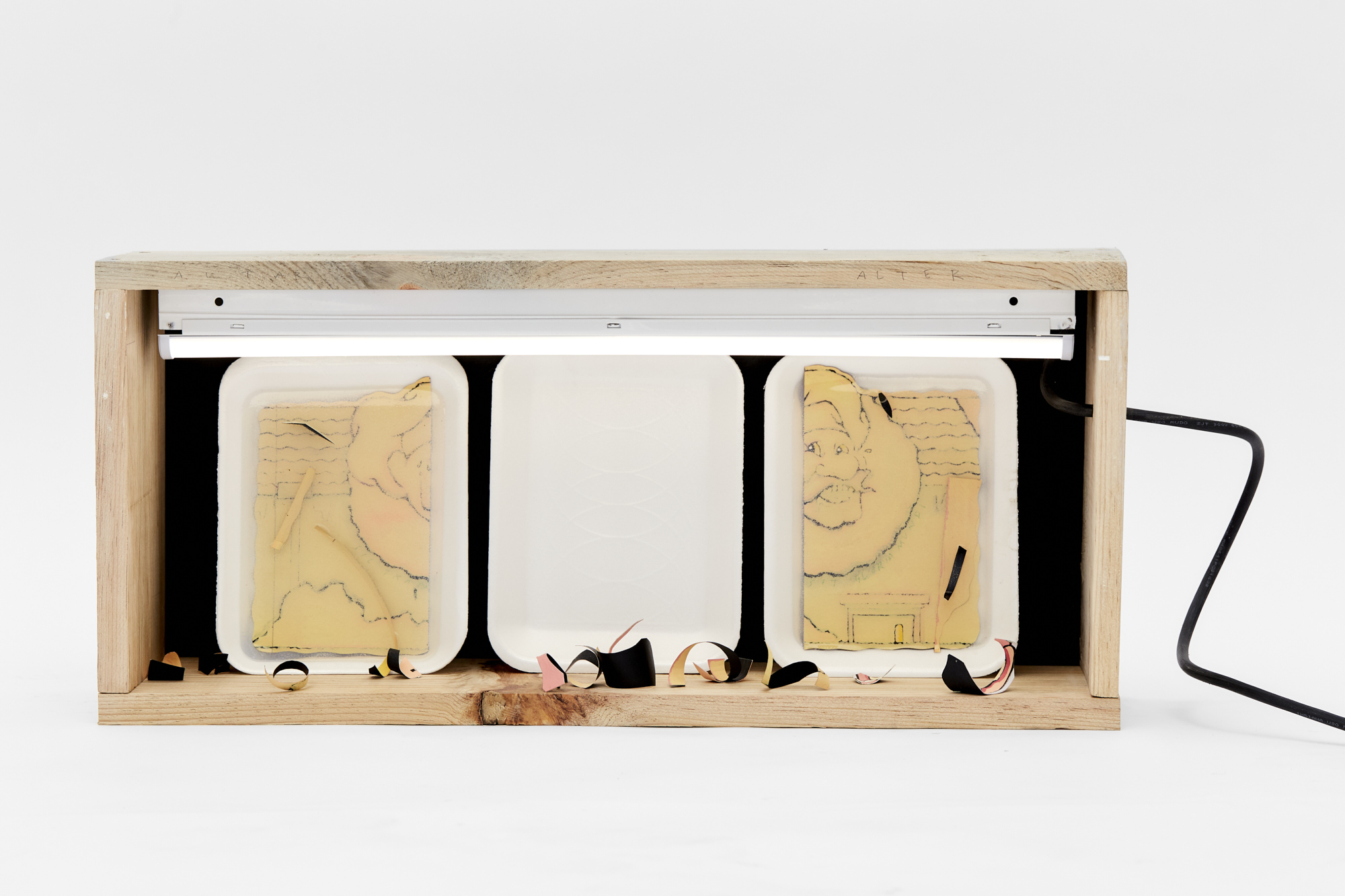 Charlie Godet Thomas, Takeaway (Altar Piece, Alter Piece), 2020. Wood, cast rubber, paper, acrylic paint, watercolour pencil, electrical fitting, bulb, paper offcuts, polystyrene. 29 x 64 x 15 cm.