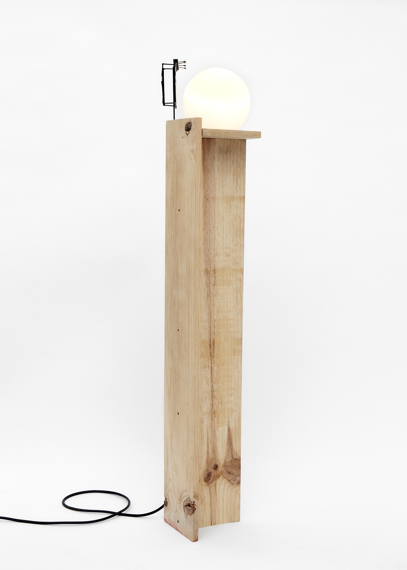 Charlie Godet Thomas, Rooftop Poem (Harvest), 2020. Wood, cut section of paper palette, glass, electrical light fitting, bulb, wooden dowels, plastic, screws, glue, acrylic paint. 139 x 21 x 19 cm.