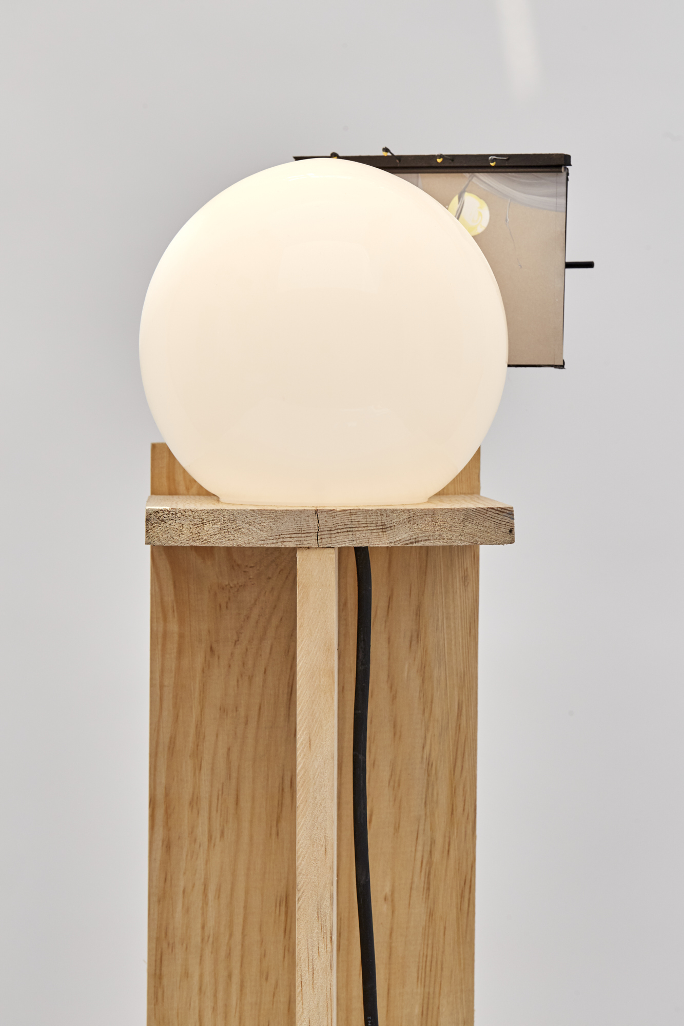 Charlie Godet Thomas, Rooftop Poem (Harvest) (detail), 2020. Wood, cut section of paper palette, glass, electrical light fitting, bulb, wooden dowels, plastic, screws, glue, acrylic paint. 139 x 21 x 19 cm.
