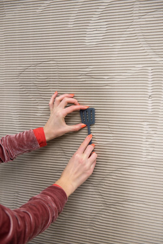 Kara Chin, Cardboard Wall, 2020. Interactive cardboard installation at DKUK, London, UK. Dimensions variable.