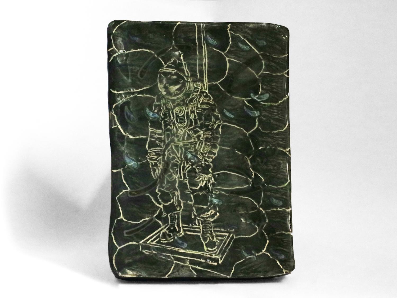 Kara Chin, Spacesuit, 2020. Glazed ceramic. 15 x 11 x 1 cm.