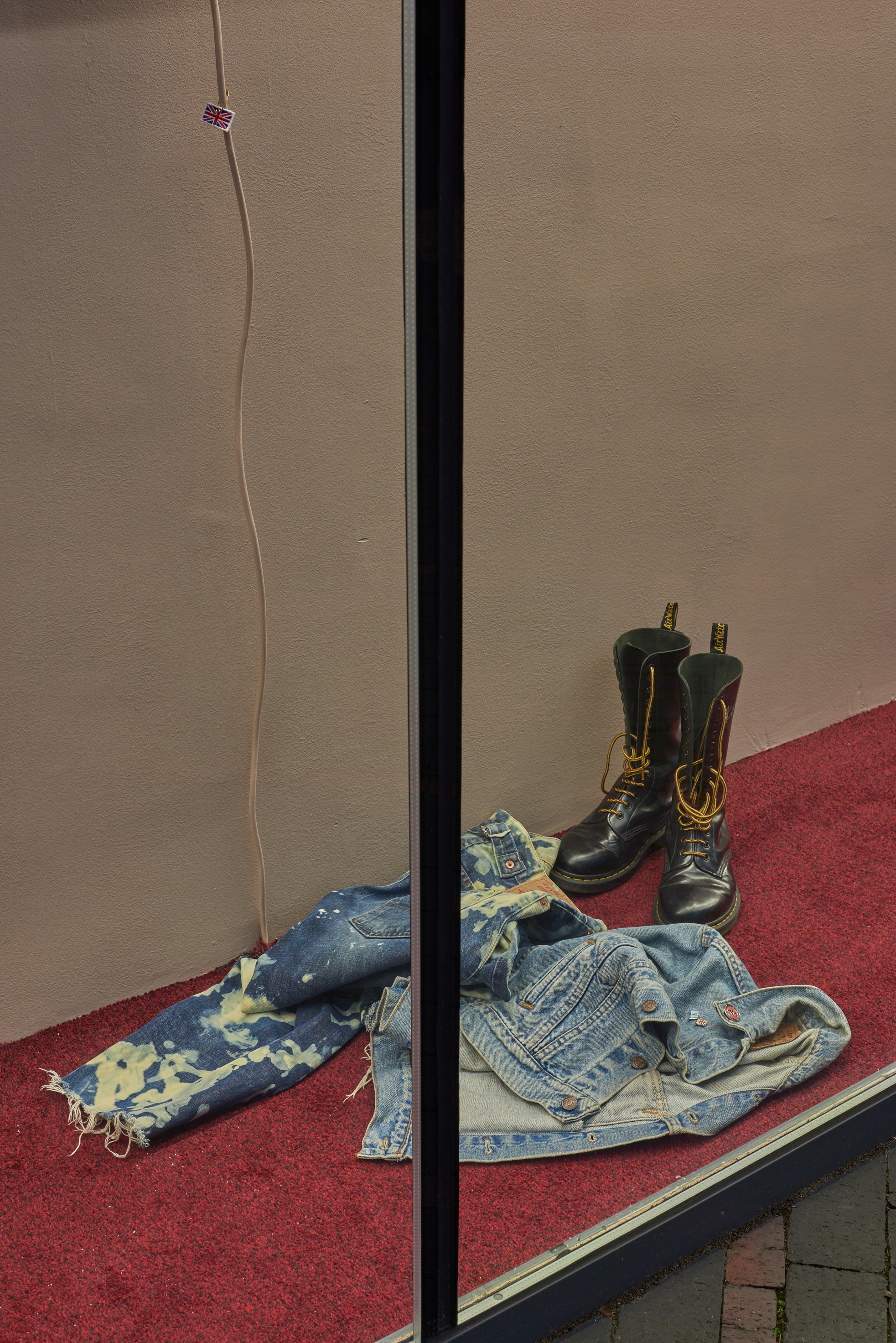 Rene Matić, Muddy Puddle, 2020. House-hold paint, carpet, Levi jeans, Fred Perry, Dr Martens. Dimensions variable. Photographer: Jonathon Bassett.