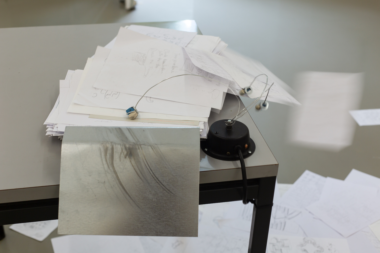 Sam Porritt, Duty of Care, 2020. Assorted studio drawings, motor, steel, table. Dimensions Variable.