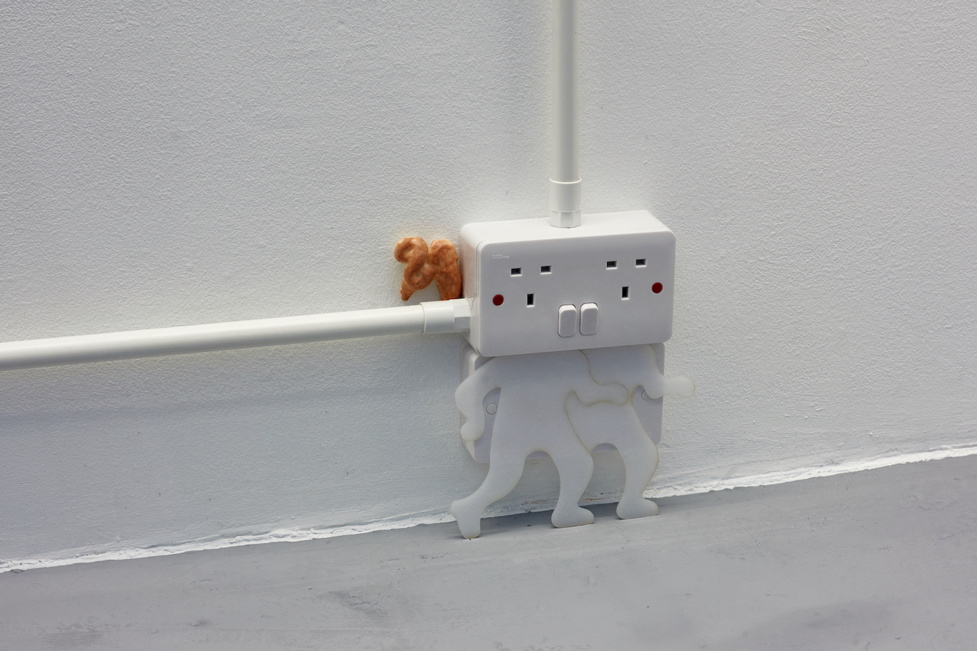 Kara Chin, Shocked Plugs II, 2021. Plug sockets, Perspex, PVC conduit, expandable foam, oil paint. 22 x 17 x 6 cm. Photographer: Jonathan Bassett.