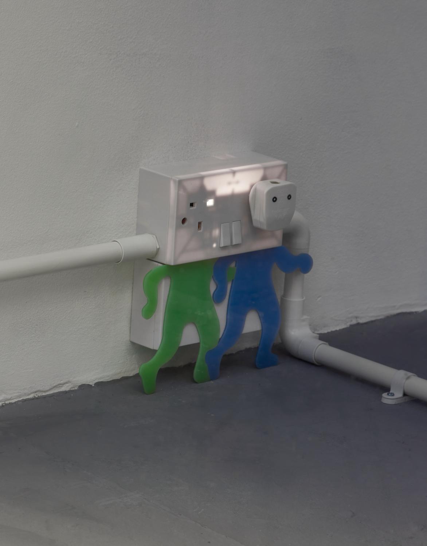 Kara Chin, Shocked Plugs III, 2021. Plug sockets, Perspex, PVC conduit. 22 x  17 x 6 cm. Photographer: Jonathan Bassett.