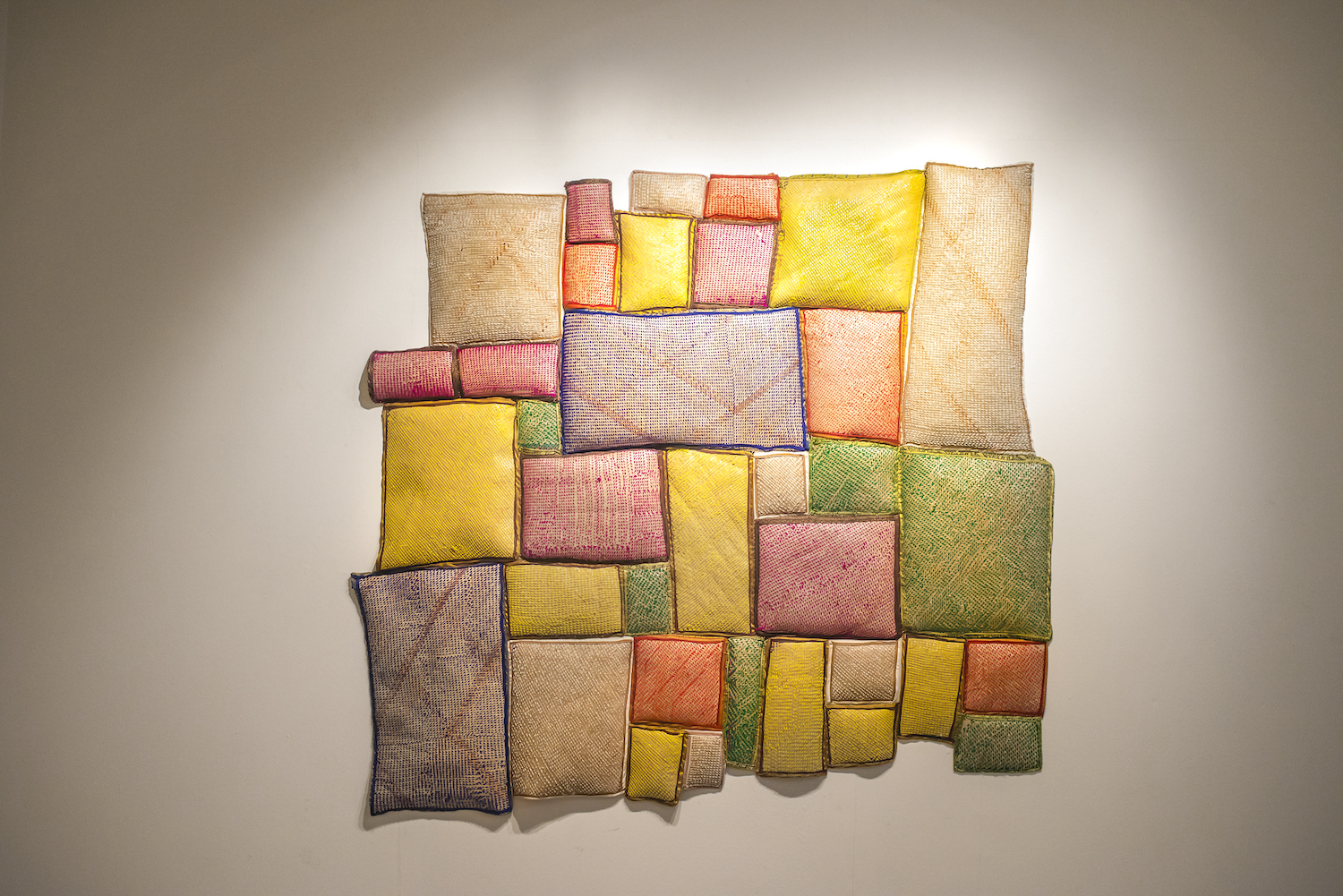 Ashfika Rahman, Redeem, 2020. Stitching on 'Shital pati' (a local handmade fabric made by indigenous community Oraon); Wool and recycled Saree. C-type print on archival paper with stitching in wool. 183 x 183 cm (Textile) / 15.24 x 15.24 cm (Photograph).