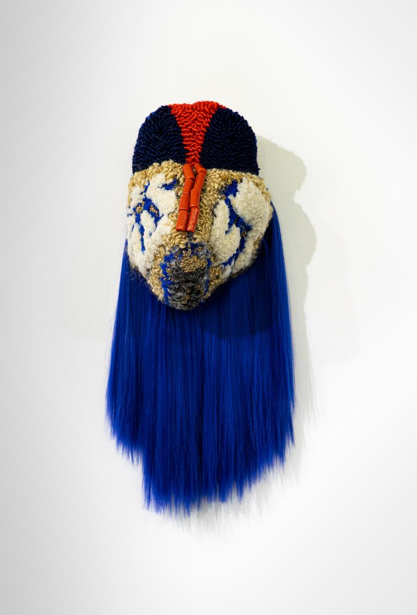 Anna Perach, Tin Women, 2020. Tufted hair, artificial hair, beads. 70 x 25 x 25 cm.