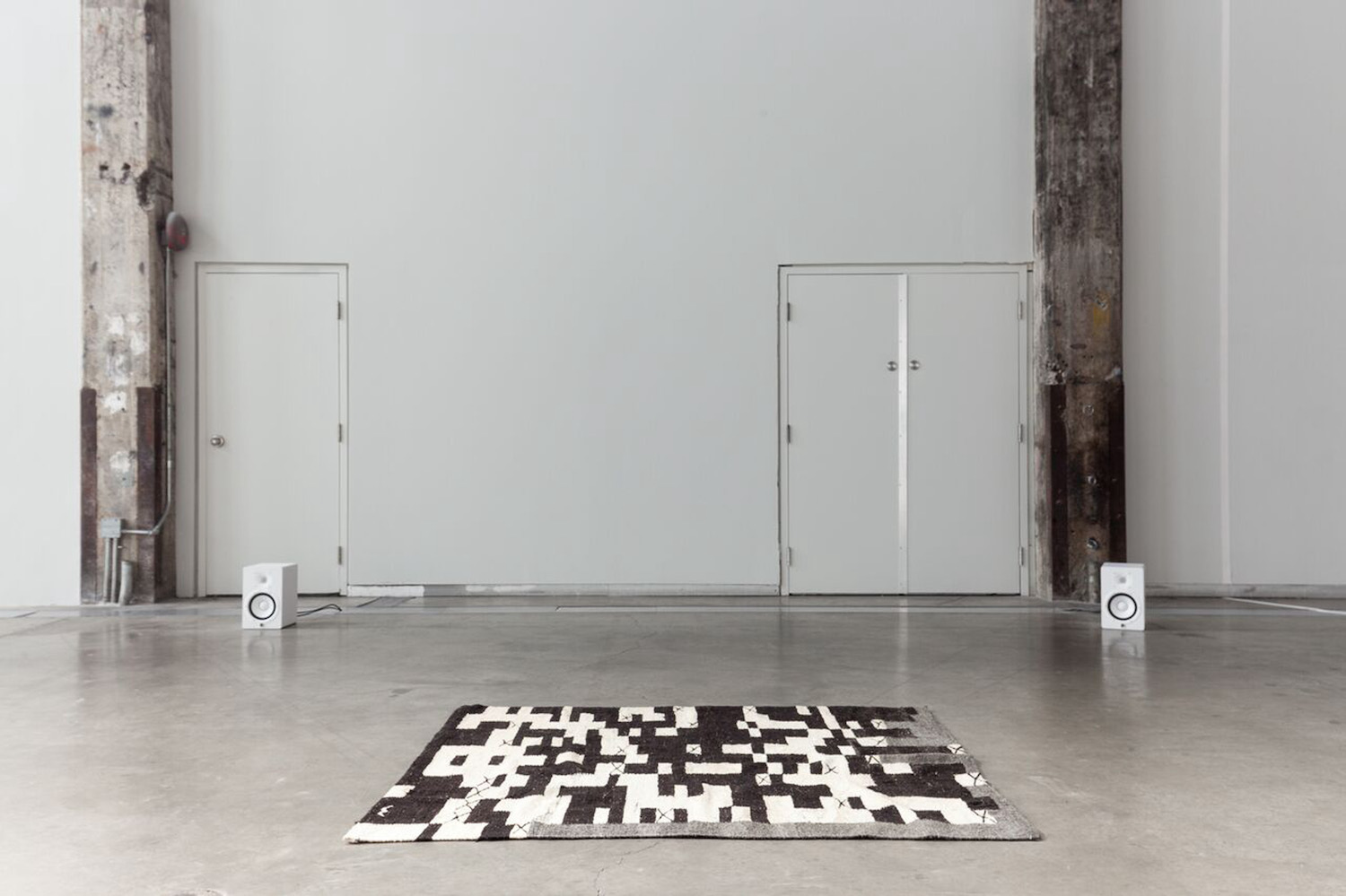 Nicole Bachmann, A is black, white, white, white, white, 2015. Audio with wool hand woven rug. Dimensions variable. Rug dimensions: 170 x 160 cm.