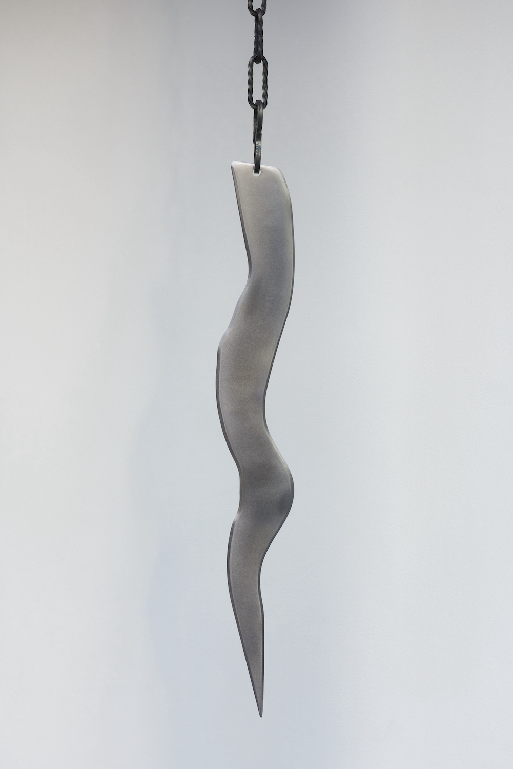 Tarek Lakhrissi, BETRAYING TIME AND SPACE, 2021. Steel and steel chains. 65 x 8 x 0.5 cm. Photographer: Jonathan Bassett.