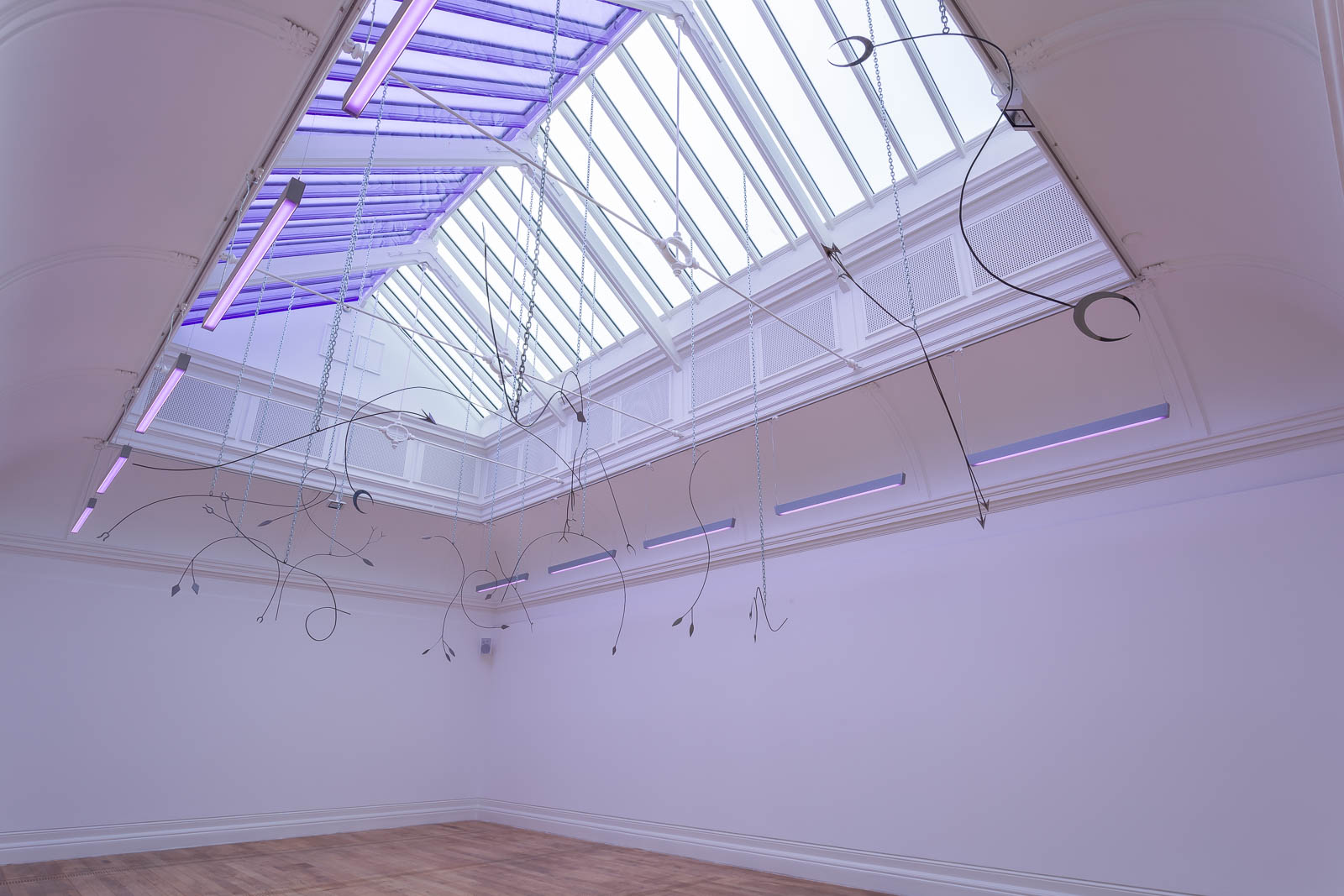 Tarek Lakhrissi, Unfinished Sentence II, 2020. Installation of 30 metal spears and performance with chains, colour filter, loud speakers. MOSTYN, Llandudno, UK. Photographer: Mark Blower.