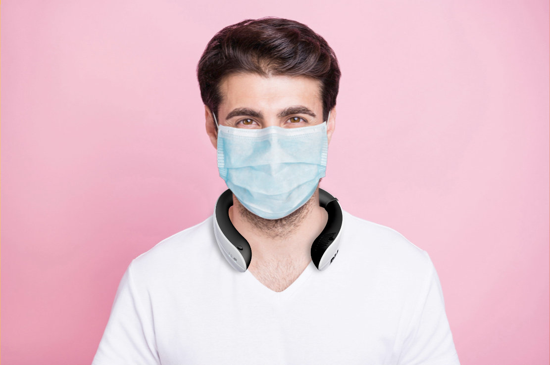 Young man wearing RIA with mask against pink background