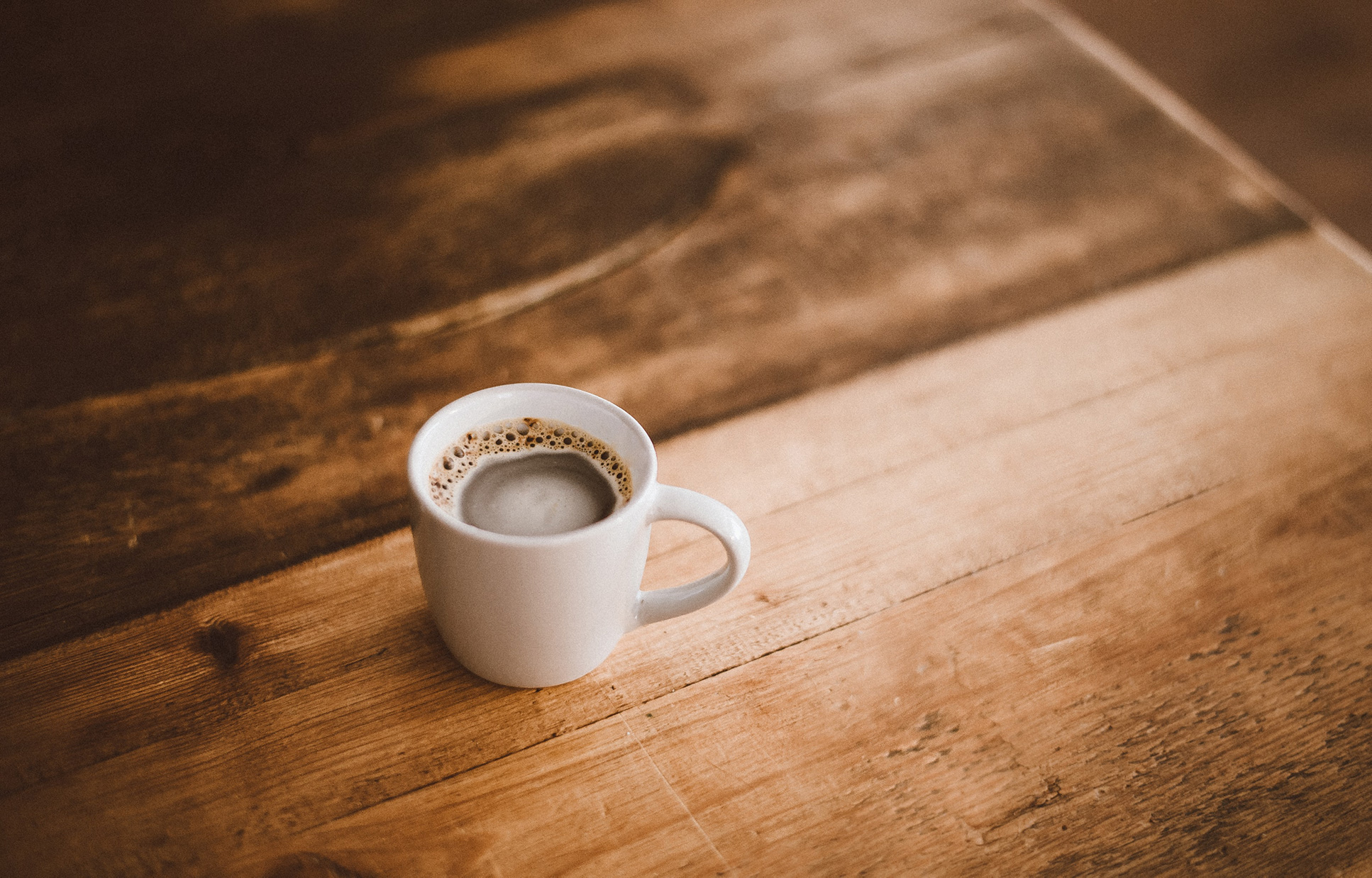 Image of a coffee cup on wooden counter