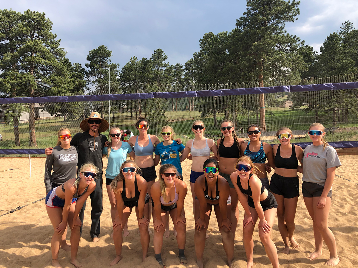 group photo playing sand volleyball