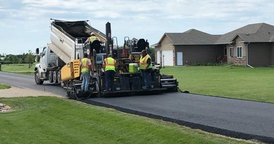 Jensen crew installing asphalt on driveway