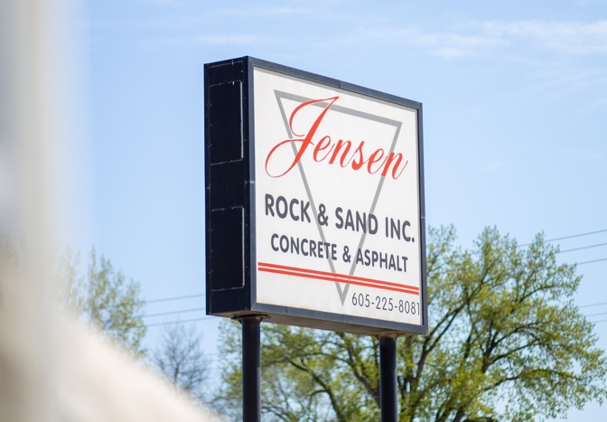Jensen Rock and Sand sign