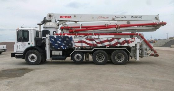 concrete pump truck with American flag decal
