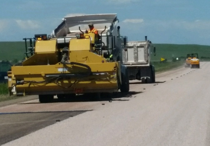 chip seal crew working on a road