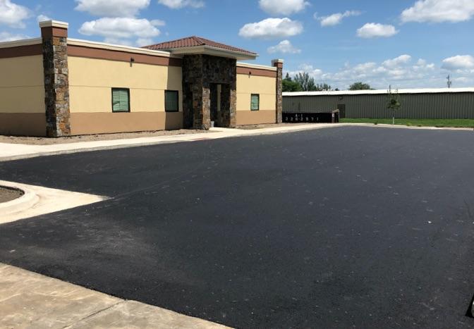 new asphalt paved parking lot