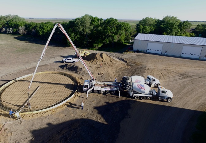 aerial view of pump truck at new grain bin site