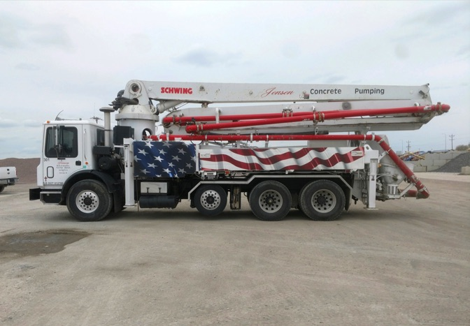 side view of pump truck with American flag decal