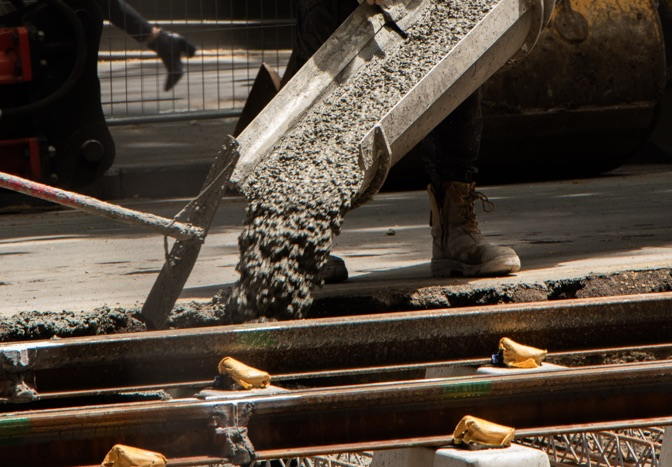 crew pouring concrete
