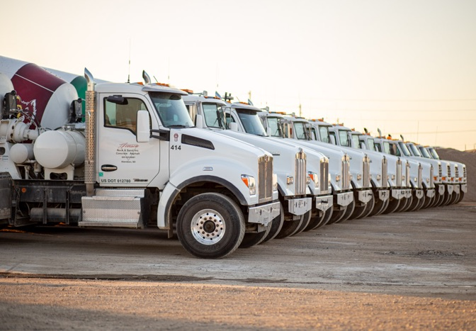 jensen concrete trucks parked in a line