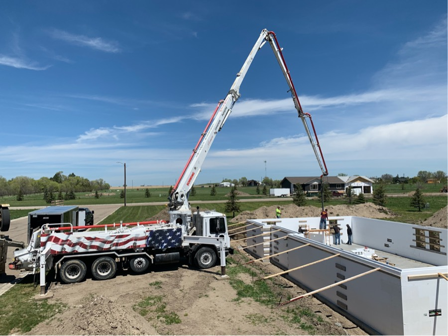 Pump truck pouring new house walls