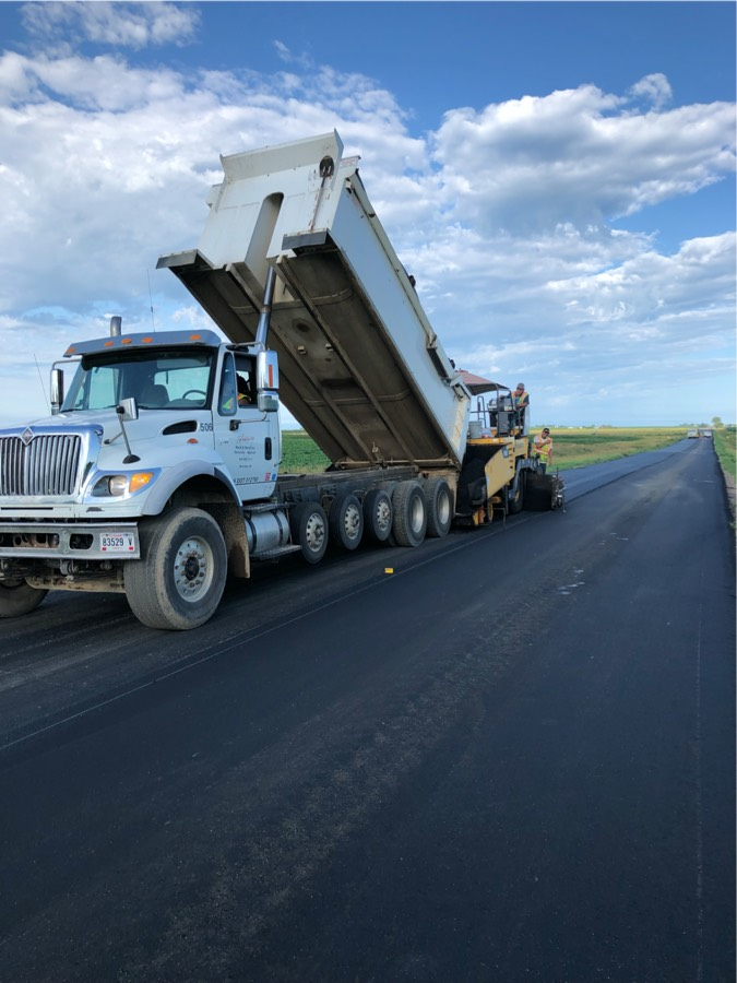 asphalt crew on new road
