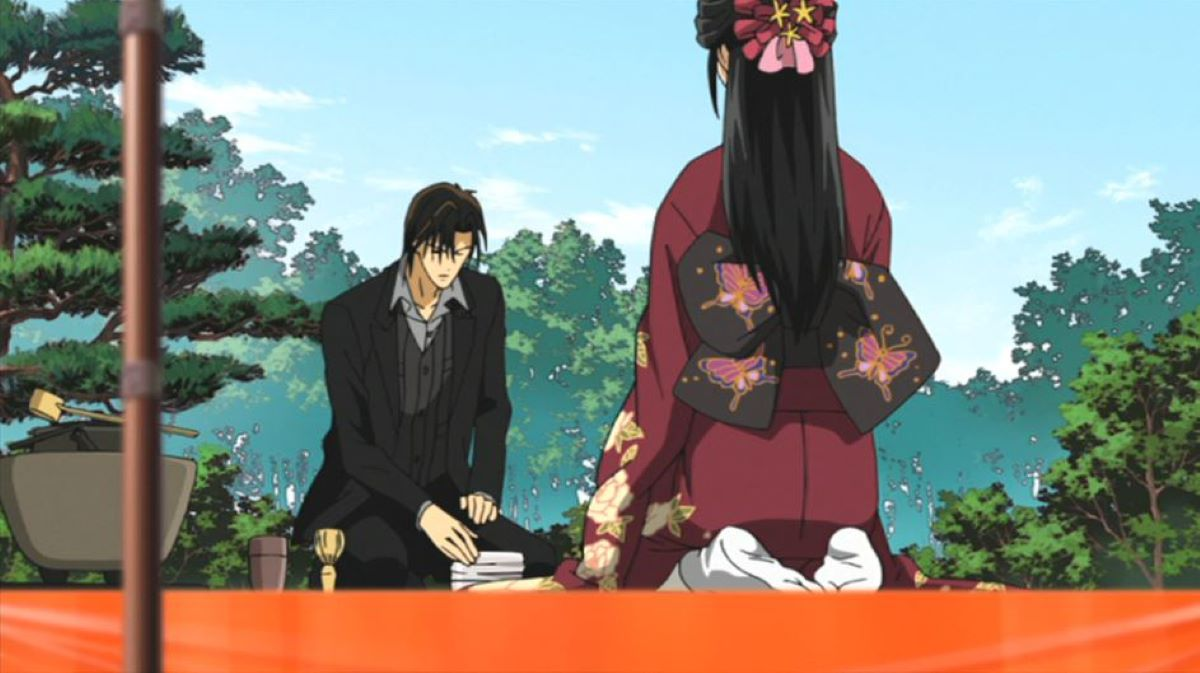 Kyoko sitting seiza style as Ren drinks in the tea garden | Elegance and natural beauty | The Japanese Tea Ceremony