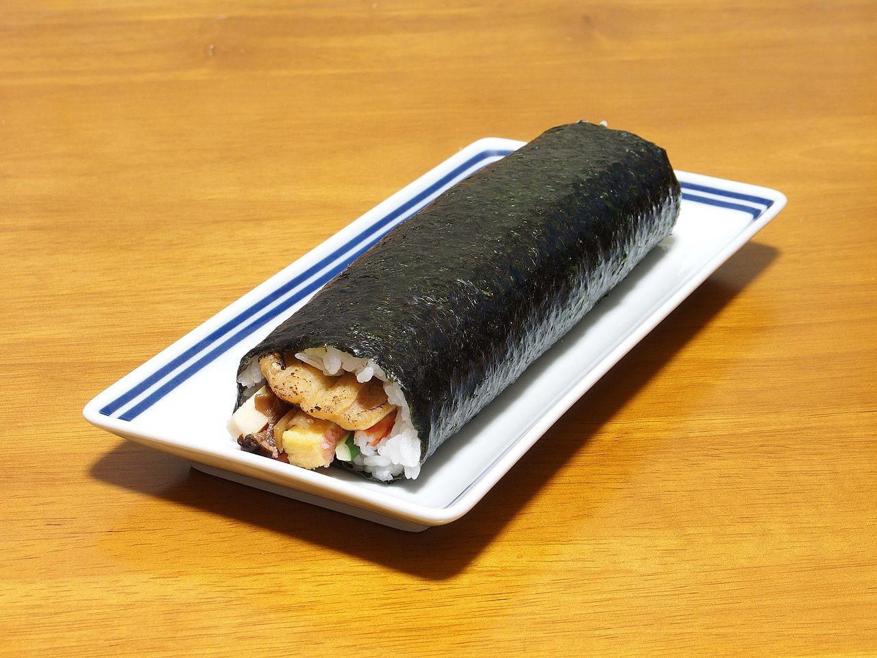 A long sushi roll on a plate | Eat Ehomaki for Luck | Setsubun