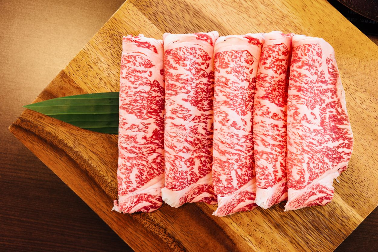 Wagyu beef cut thin on a wooden board | Marbling | Wagyu Beef