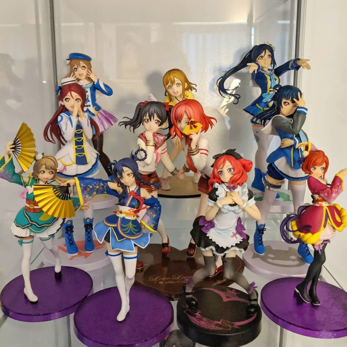 Love Live! Figures displayed on a shelf using risers | Risers | Fun Ways to Display Your Figure Collection