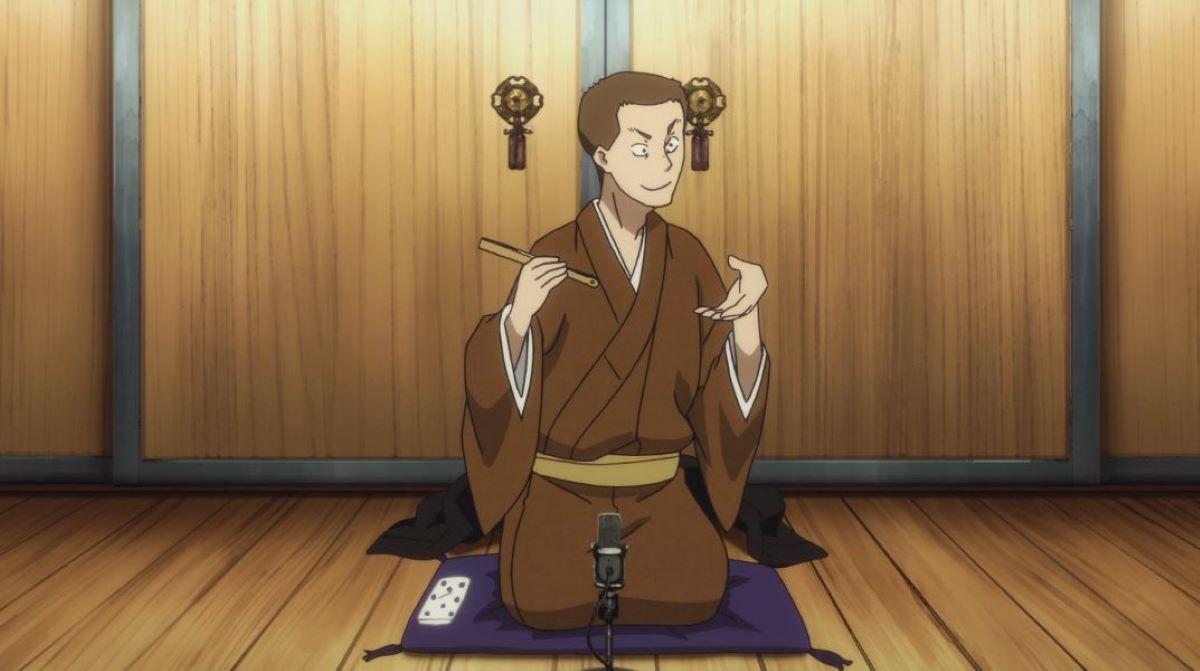 Yotarou performing, using his fan to mimic eating soba noodles | What is Rakugo? | What is Rakugo?
