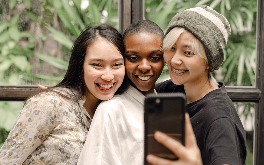 Social media aggregator for the community. Image of friends posing.
