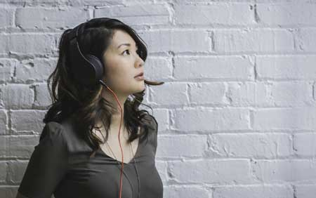 A person listening to music on the headphones