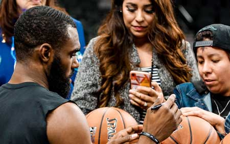 The NBA team Dallas Mavericks giving autographs to their fans. A great example of a sports team using social media to connect to their fans.