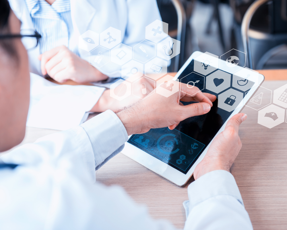 Healthcare providers looking at electronic devices