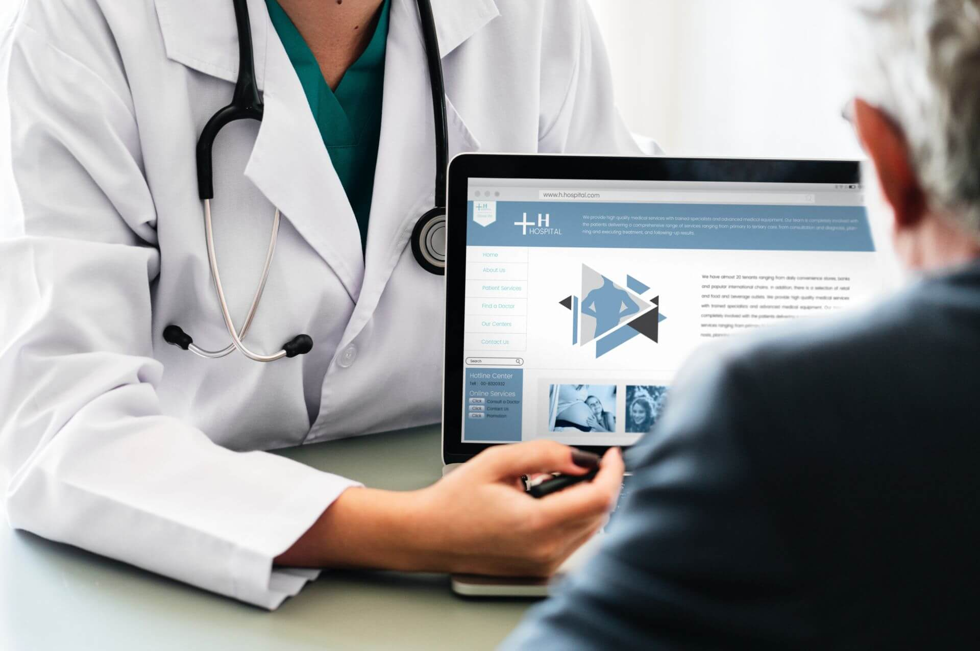 Healthcare provider showing man assessment on laptop