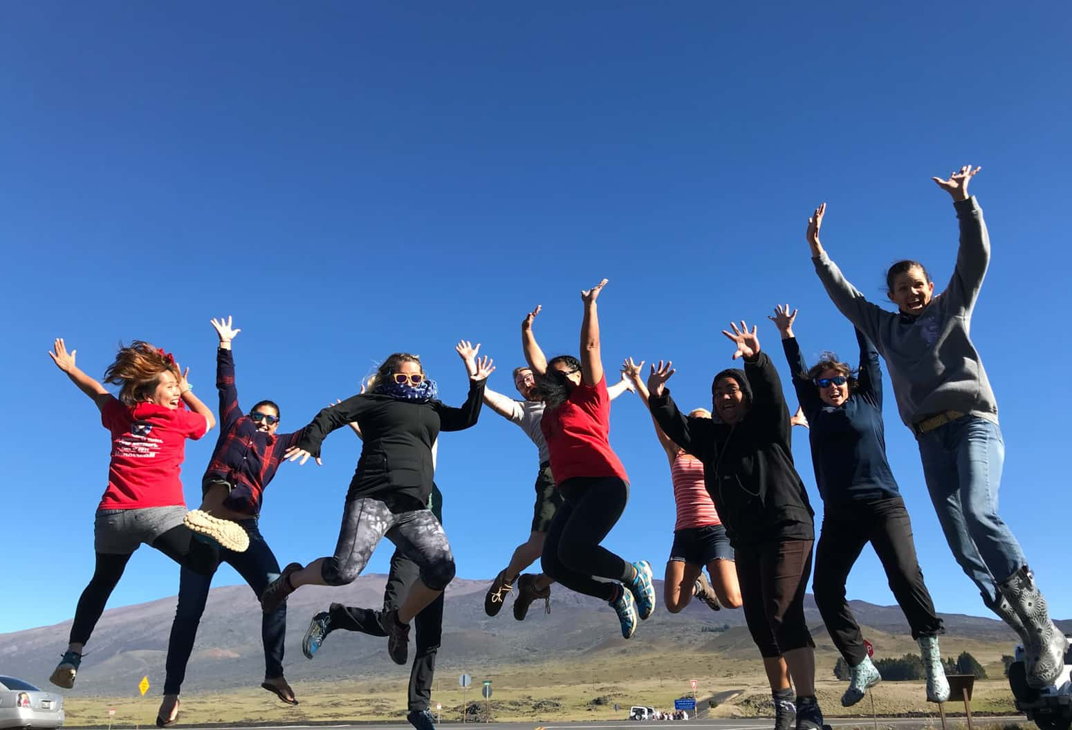 A group of teachers jumping with joy