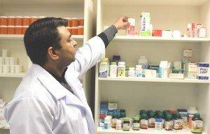 Pharmacist getting medicine.