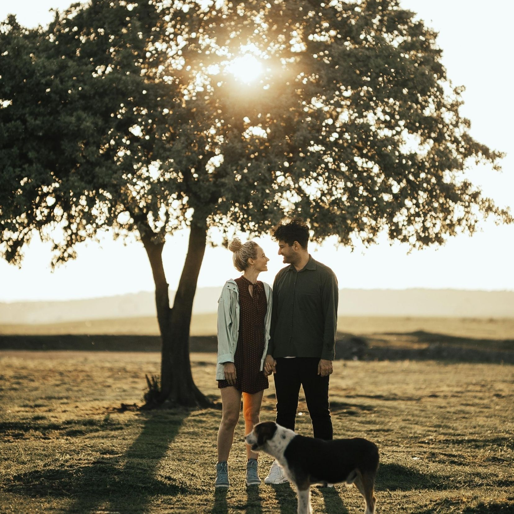 couple spending quality time together with dog in nature