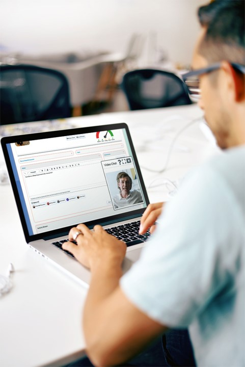 A man looks at his Oqea.net account on a laptop
