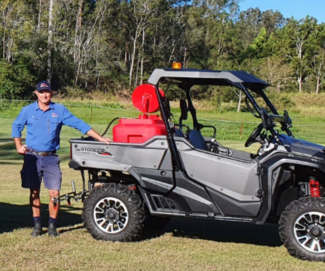 Tim Sambell standing next to his Epest quad bike